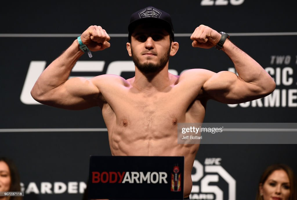 Islam Makhachev of Russia poses on the scale during the UFC 220 weigh-in at TD Garden on January 19, 2018 in Boston, Massachusetts.