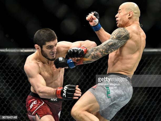 Islam Makhachev of Russia punches Gleison Tibau of Brazil in their lightweight bout during the UFC 220 event at TD Garden on January 20 2018 in...