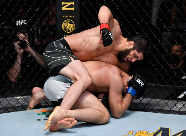 Islam Makhachev of Russia punches Thiago Moises of Brazil in their lightweight bout during the UFC Fight Night event at UFC APEX on July 17, 2021 in...