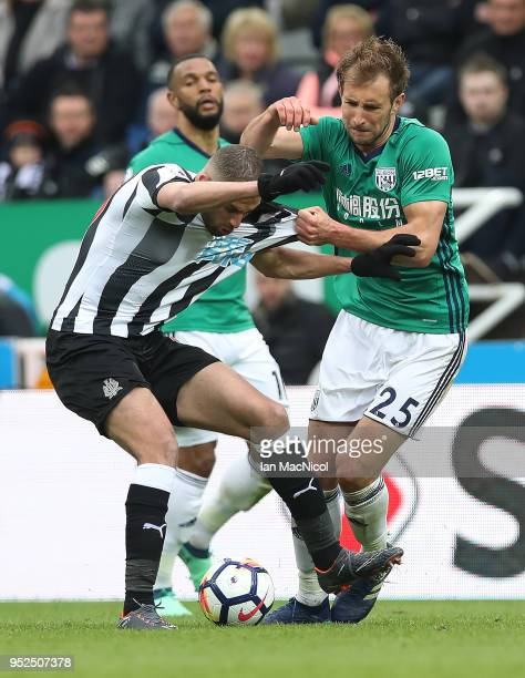 Islam Slamani of Newcastle United vies with Craig Dawson of West Bromwich Albion during the Premier League match between Newcastle United and West...