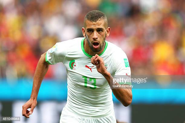 Islam Slimani of Algeria celebrates scoring his team's first goal during the 2014 FIFA World Cup Brazil Group H match between South Korea and Algeria...