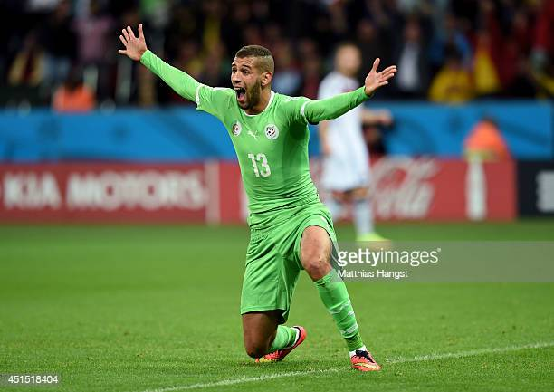 Islam Slimani of Algeria reacts after scoring a goal but being called offsides during the 2014 FIFA World Cup Brazil Round of 16 match between...