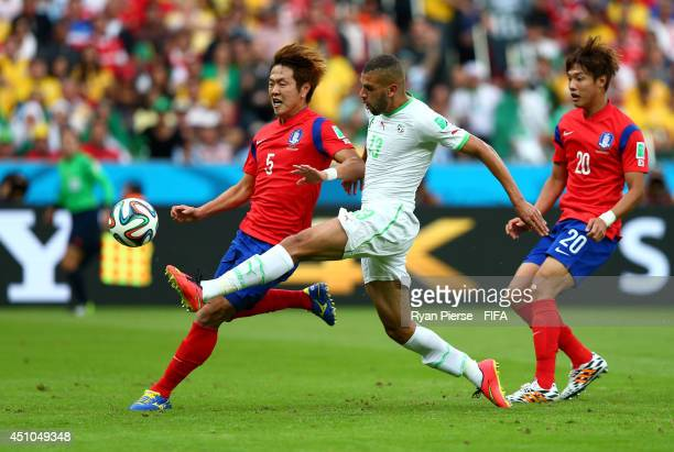 Islam Slimani of Algeria scores his team's first goal during the 2014 FIFA World Cup Brazil Group H match between Korea Republic and Algeria at...