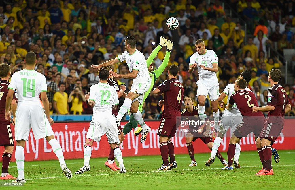 Islam Slimani of Algeria scores his team's first goal past goalkeeper Igor Akinfeev of Russia during the 2014 FIFA World Cup Brazil Group H match between Algeria and Russia at Arena da Baixada on June 26, 2014 in Curitiba, Brazil.