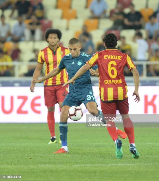 Islam Slimani of Fenerbahce in action against Guilherme Costa Marques during the Turkish Super Lig soccer match betweenEvkur Yeni Malatyaspor and...