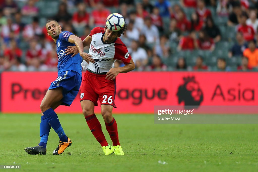 Islam Slimani of Leiceister City holds off Ahmed Hegazy of West Bromwich Albion during the Premier League Asia Trophy match between Leicester City and West Bromwich Albion at Hong Kong Stadium on July 19, 2017 in Hong Kong, Hong Kong.