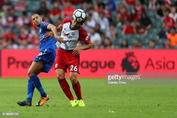 Islam Slimani of Leiceister City holds off Ahmed Hegazy of West Bromwich Albion during the Premier League Asia Trophy match between Leicester City...