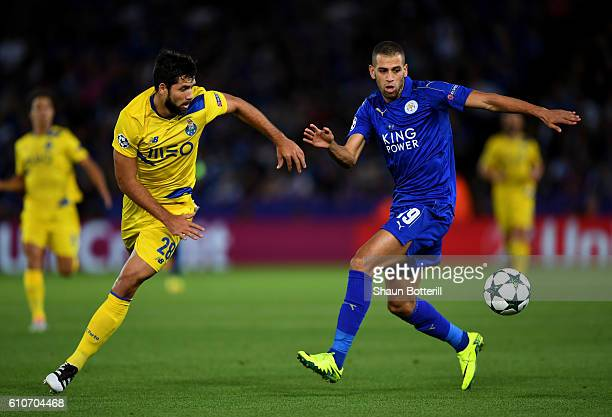 Islam Slimani of Leicester City and Felipe of FC Porto watch the ball during the UEFA Champions League Group G match between Leicester City FC and FC...