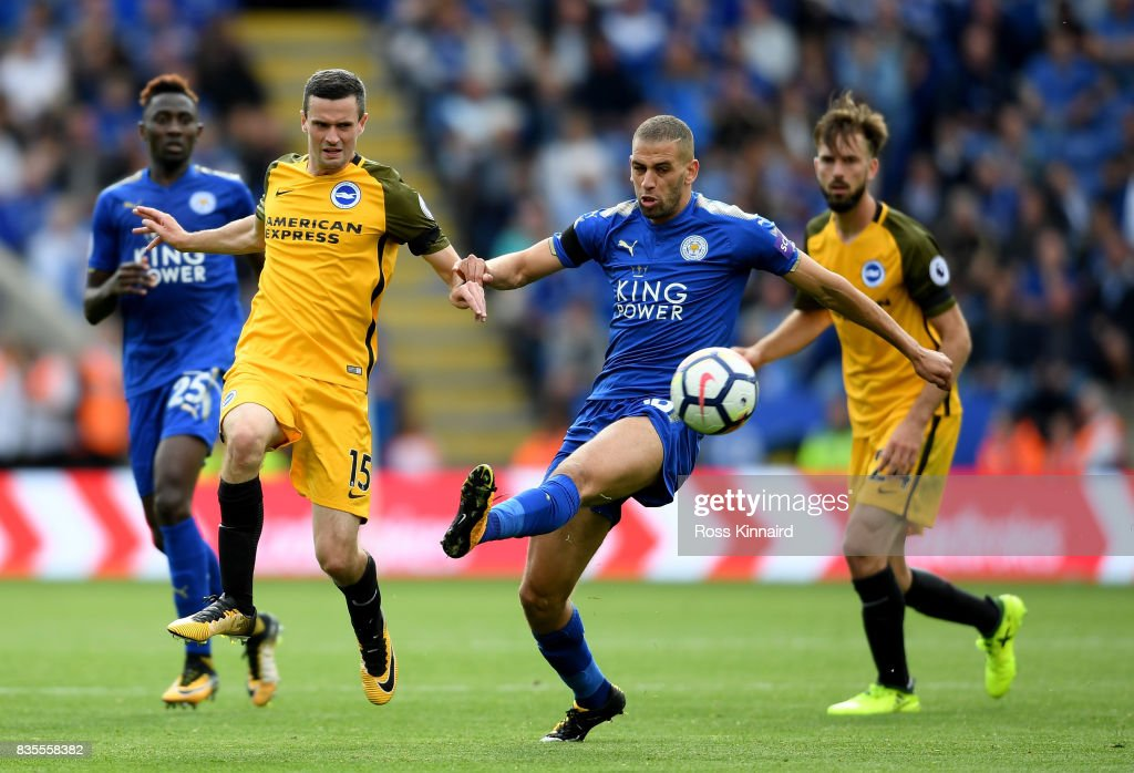 Islam Slimani of Leicester City and Jamie Murphy of Brighton and Hove Albion battle for possession during the Premier League match between Leicester City and Brighton and Hove Albion at The King Power Stadium on August 19, 2017 in Leicester, England.
