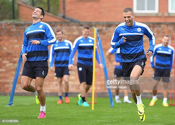 Islam Slimani of Leicester City and Luis Hernandez of Leicester City in action during a Leicester City training session ahead of their Champions...