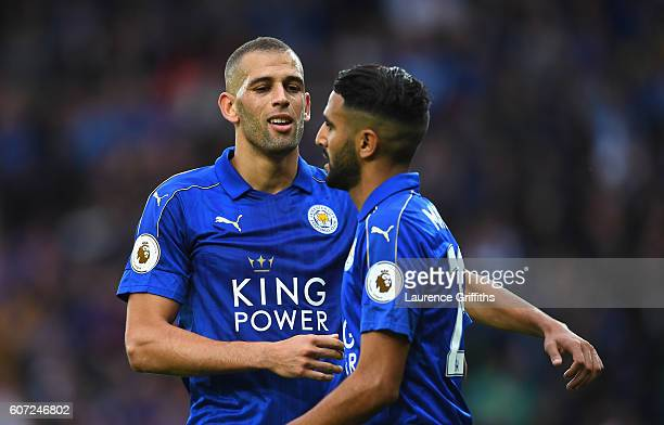 Islam Slimani of Leicester City and Riyad Mahrez of Leicester City celebrate after Ben Mee of Burnley scores a own goal during the Premier League...
