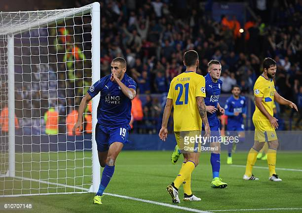 Islam Slimani of Leicester City celebrates as he scores their first goal during the UEFA Champions League Group G match between Leicester City FC and...