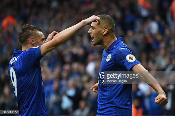 Islam Slimani of Leicester City celebrates scoring his sides first goal with Jamie Vardy of Leicester City during the Premier League match between...