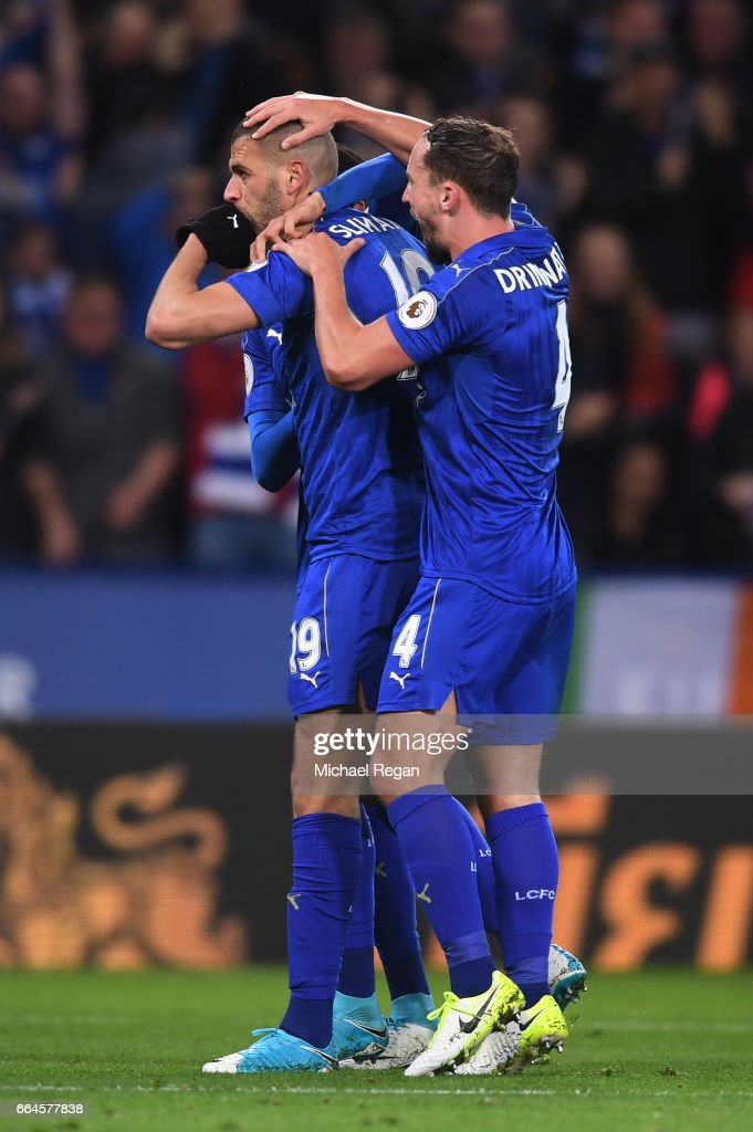 Islam Slimani of Leicester City celebrates scoring his sides first goal with Danny Drinkwater of Leicester City during the Premier League match between Leicester City and Sunderland at The King Power Stadium on April 4, 2017 in Leicester, England.