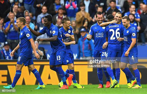 Islam Slimani of Leicester City celebrates scoring his sides second goal with his team mates during the Premier League match between Leicester City...