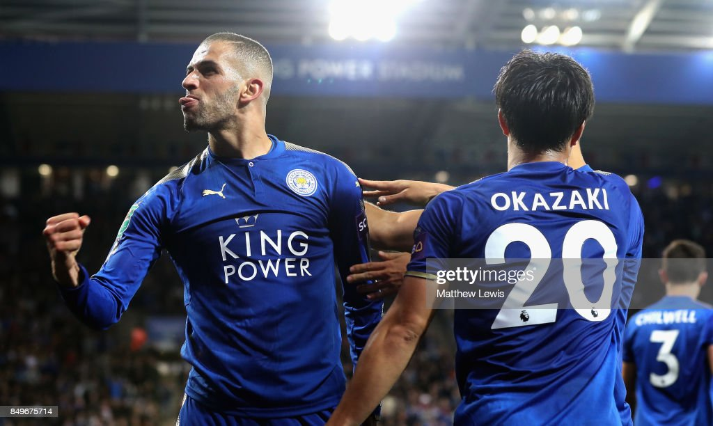 Islam Slimani of Leicester City celebrates scoring his sides second goal with Shinji Okazaki of Leicester City during the Carabao Cup Third Round match between Leicester City and Liverpool at The King Power Stadium on September 19, 2017 in Leicester, England.