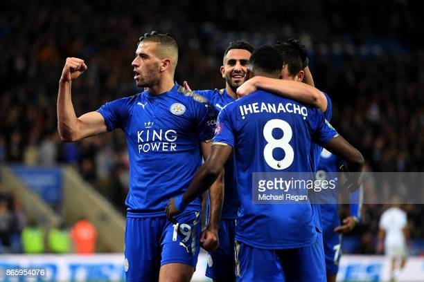 Islam Slimani of Leicester City celebrates scoring his sides second goal with team mates during the Caraboa Cup Fourth Round match between Leicester...