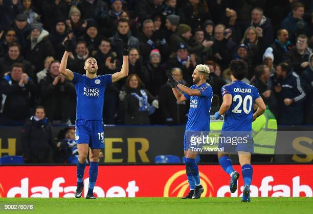 Islam Slimani of Leicester City celebrates scoring his team's second goal during the Premier League match between Leicester City and Huddersfield...