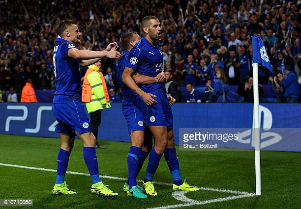 Islam Slimani of Leicester City celebrates with team mates as he scores their first goal during the UEFA Champions League Group G match between...