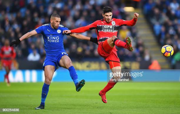 Islam Slimani of Leicester City challenges Christopher Schindler of Huddersfield Town during the Premier League match between Leicester City and...