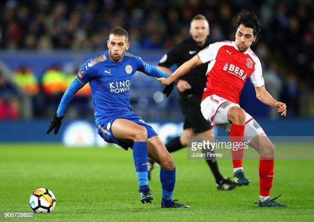 Islam Slimani of Leicester City evades Markus Schwabl of Fleetwood Town during The Emirates FA Cup Third Round Replay match between Leicester City...