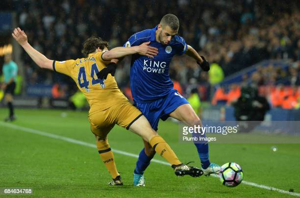 Islam Slimani of Leicester City in action with Filip Lesniak of Tottenham Hotspur during the Premier League match between Leicester City and...