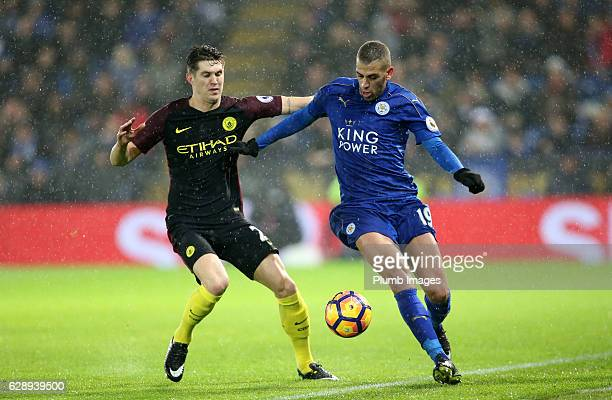 Islam Slimani of Leicester City in action with John Stones of Manchester City during the Premier League match between Leicester City and Manchester...