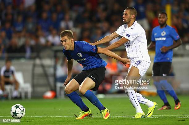 Islam Slimani of Leicester City pushes Bjoern Engels of Club Brugge during the UEFA Champions League match between Club Brugge KV and Leicester City...
