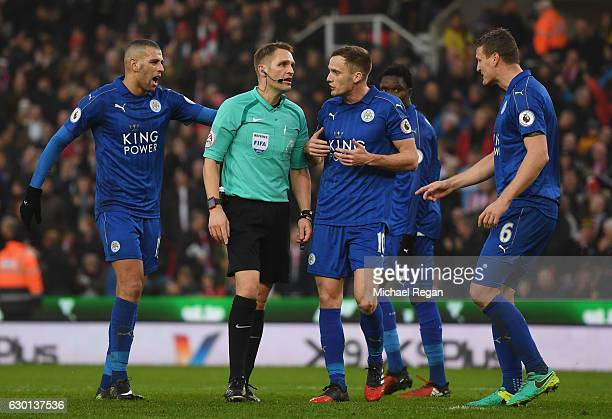 Islam Slimani of Leicester City Robert Huth of Leicester City and Andy King of Leicester City argue with referee Craig Pawson during the Premier...