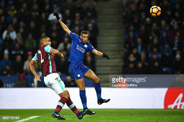 Islam Slimani of Leicester City scores his sides first goal during the Premier League match between Leicester City and West Ham United at The King...