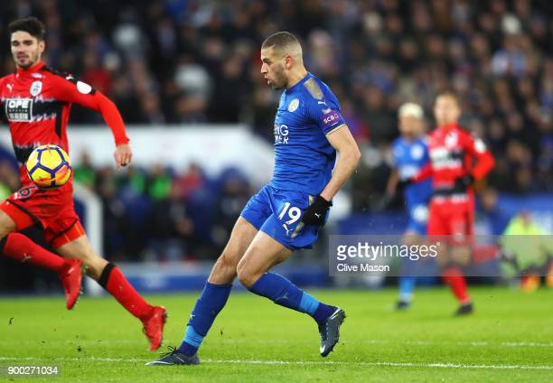 Islam Slimani of Leicester City scores his team's second goal during the Premier League match between Leicester City and Huddersfield Town at The...