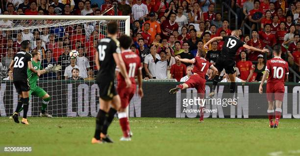 Islam Slimani of Leicester City scores the opening goal during the Premier League Asia Trophy match between Liverpool FC and Leicester City FC at the...