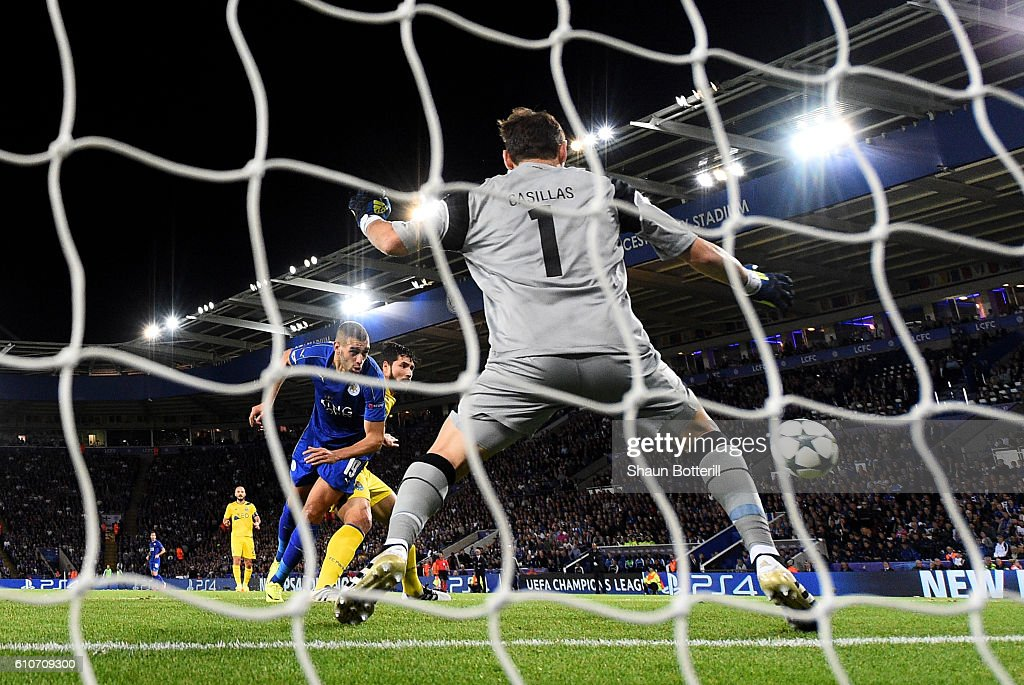 Islam Slimani of Leicester City (L) scores their first goal past Iker Casillas of FC Porto during the UEFA Champions League Group G match between Leicester City FC and FC Porto at The King Power Stadium on September 27, 2016 in Leicester, England.