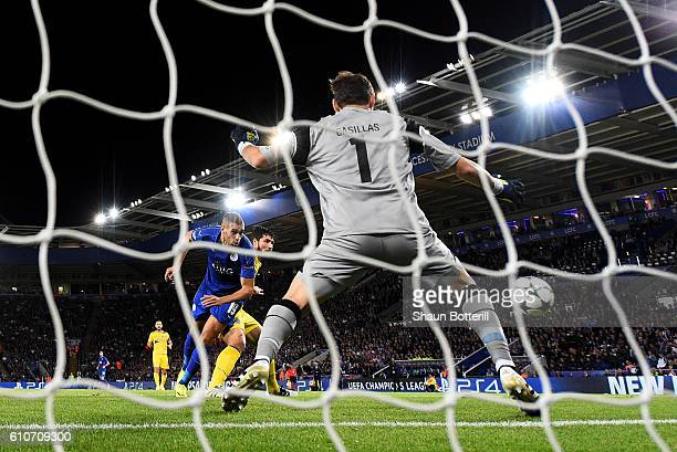 Islam Slimani of Leicester City scores their first goal past Iker Casillas of FC Porto during the UEFA Champions League Group G match between...