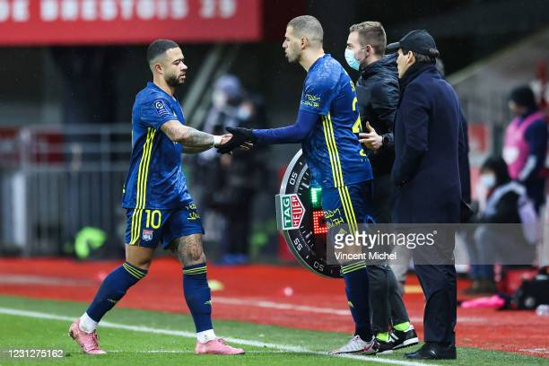 Islam Slimani of Lyon and Houssem Aouar of Lyon and Rudy GARCIA coach of Lyon during the Ligue 1 soccer match between Stade Brestois 29 and Olympique...