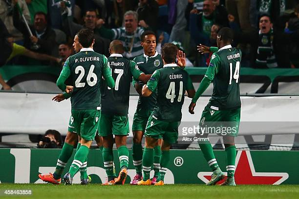 Islam Slimani of Sporting Lisbon celebrates scoring their fourth goal with team mates during the UEFA Champions League Group G match between Sporting...