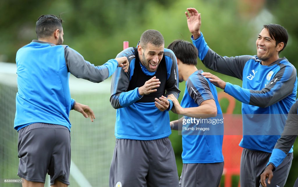 Islam Slimani shares a joke with Leo Ulloa during the Leicester City training session at Belvoir Drive Training Complex on August 17 , 2017 in Leicester, United Kingdom.