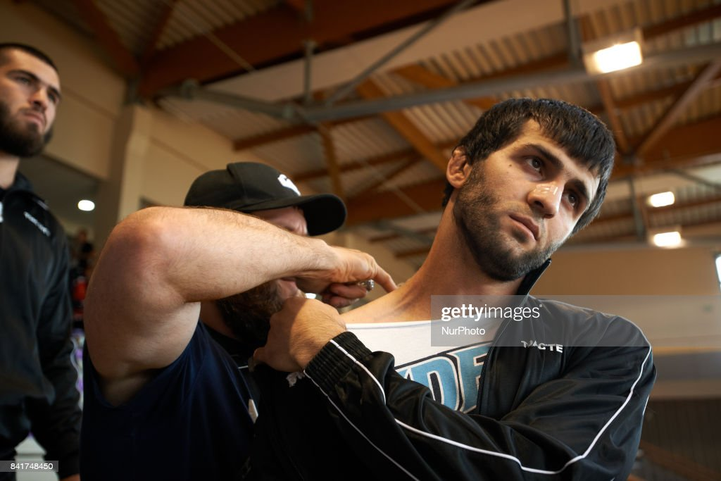 Islam, the trainor of the TOAC Wrestling Club, is been massaged by Iba, another wrestler before entering the FSGT World Championship. On 1st September 2017 in Clermond-Ferrand, France.