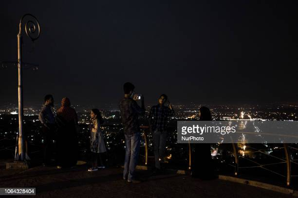 Islamabad Pakistan 24 September 2018 Families photograph themselves at night on the Margalla hill overlooking the city