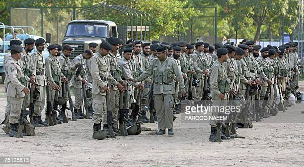 A Pakistani Ranger officer checks his troops as they stand in formation outside the Red Mosque in Islamabad 06 July 2007 A Pakistani cleric besieged...