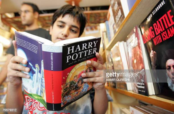 A Pakistani youth reads a copy of 'Harry Potter and the Deathly Hallows' at a bookstore in Islamabad 21 July 2007 Pakistan police said 21 July they...