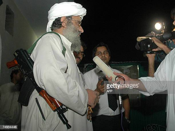 Abdul Rashid Ghazi deputy head of the Red Mosque carries a gun as he speaks with media at an Islamic seminary in Islamabad 27 June 2007 A radical...