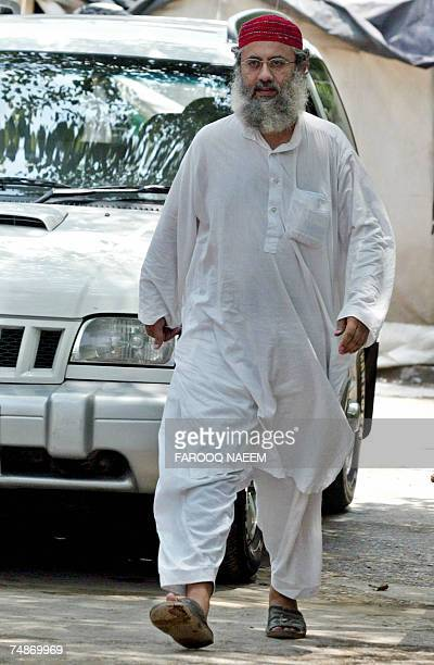 Abdul Rashid Ghazi one of two brothers who head the Red Mosque steps towards media representatives gathred at the Jamia Hafsa seminary where nine...