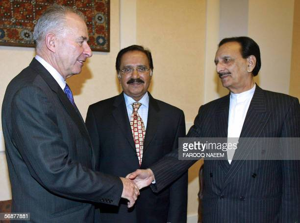 Commonwealth Chief Don McKinnon shakes hands with Pakistani opposition leader Raja ZaffarulHaq as Amin Fahim looks on during a meeting in Islamabad18...