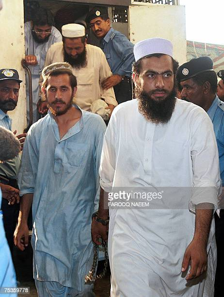 CORRECTION Detained Pakistani religious students of the Red Mosque come out of a police van as they arrive from the Adiala jail where they were...