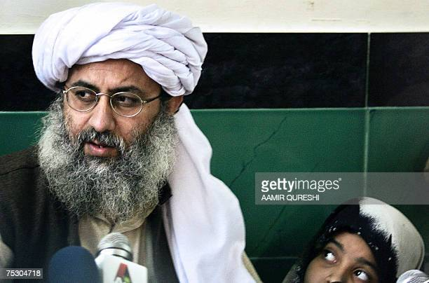 File picture taken 12 February 2007 shows Maulana Abdul Rashid Ghazi deputy chief cleric at Islamabad's Red Mosque watched by his daughter as he...