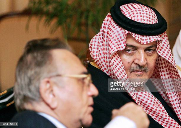 Foreign Minister of Saudi Arabia Prince Saud Al Faisal listens to Pakistani Foreign Minister Khurshid Kasuri during an Islamic Ministers Conference...