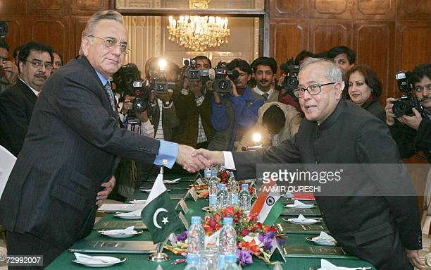 Indian Foreign Minister Pranab Mukherjee shakes hands with his Pakistani counterpart Khurshid Kasuri prior to their meeting in Islamabad 13 January...