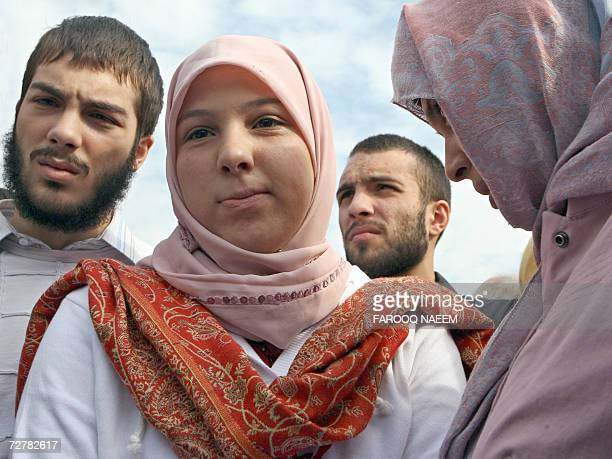 Molly Campbell who is also known by her Muslim name Misbah Iram Ahmad Rana listens to her friend Rabia Khalid and brothers Adam Ahmed Rana and Omar...