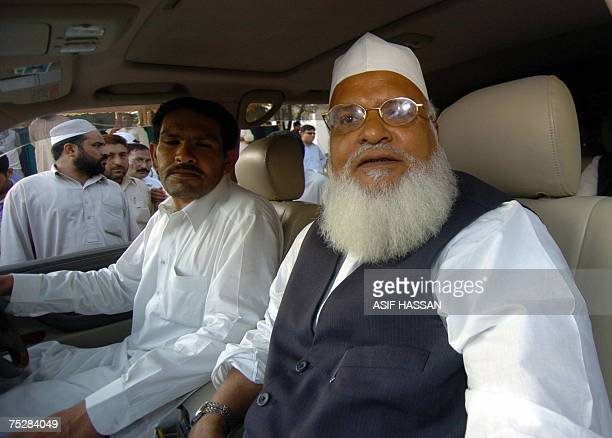 Pakistani cleric Mufti Rafi Usmani one of the clerics of an eleven member delegation arrives near The Red Mosque in Islamabad 09 July 2007 ahead of...